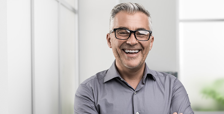 Older man smiling wearing glasses