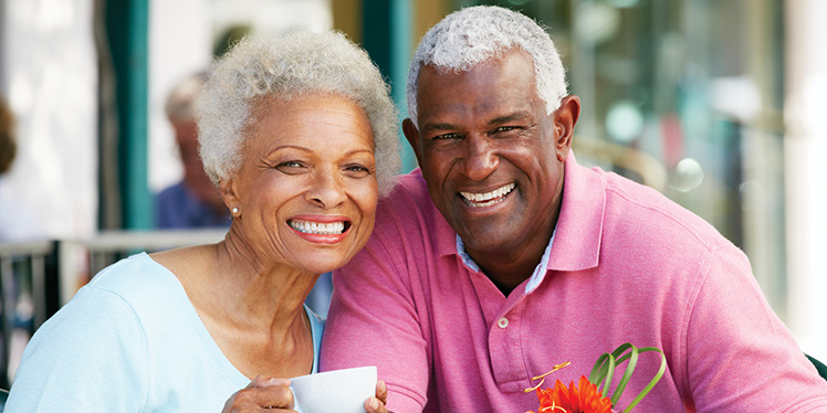 Older couple smiling drinking coffee