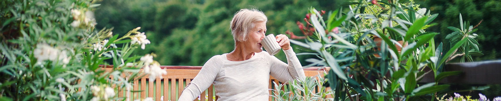 lady drinking coffee with dentures